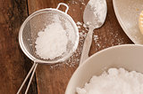 Kitchen sieve filled with icing sugar