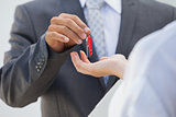 Estate agent giving the key to buyer