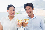 Happy couple having white wine
