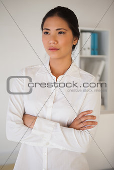 Casual businesswoman with arms crossed