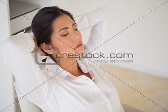 Casual businesswoman napping at her desk