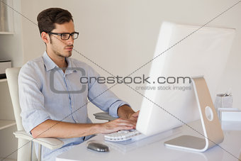 Casual businessman working at his desk