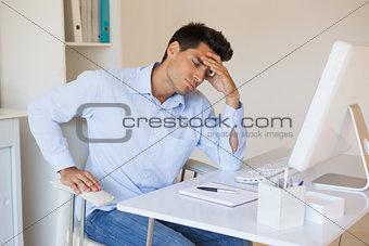 Casual businessman getting a headache