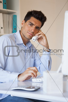 Casual businessman talking on the telephone
