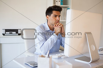 Casual businessman sitting at his desk