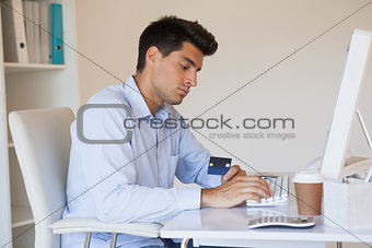 Casual businessman shopping online at his desk
