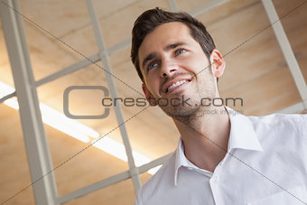 Casual businessman standing with happy expression