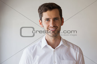 Casual businessman smiling at camera