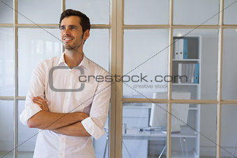 Casual businessman smiling with arms crossed