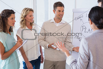 Casual businessman giving presentation to colleagues