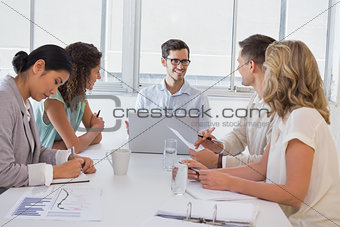 Casual businessman talking to team during meeting