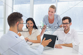 Casual businessman using laptop during meeting