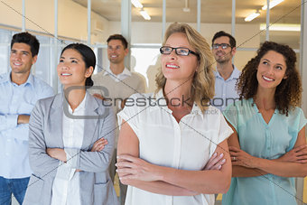 Casual business team smiling with arms crossed looking up
