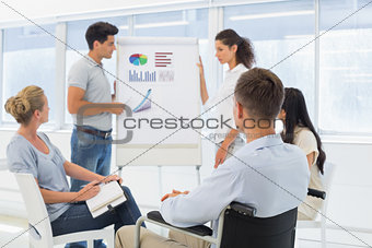 Casual businessman in wheelchair listening to presentation