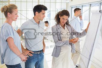 Pregnant businesswoman presenting her ideas