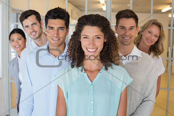 Casual happy business team smiling at camera together