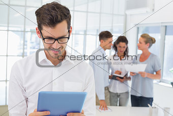 Casual businessman using his tablet