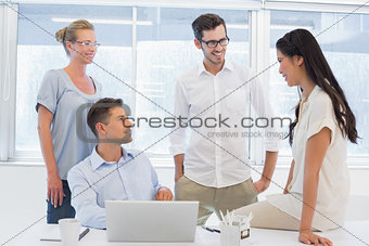 Casual business team chatting together