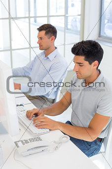 Casual businessmen working at desk