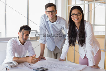 Casual architecture team working together smiling at camera