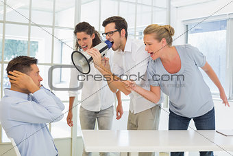 Casual business team shouting at a colleague
