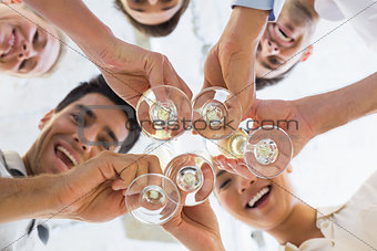 Casual business team toasting with champagne