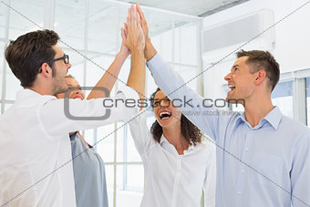 Casual business team high fiving