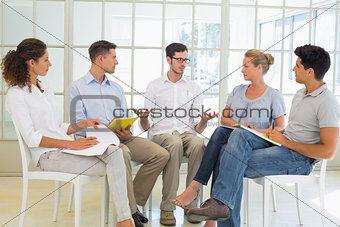 Casual business team sitting in a circle having a meeting