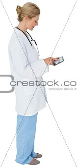 Blonde doctor in lab coat using tablet pc