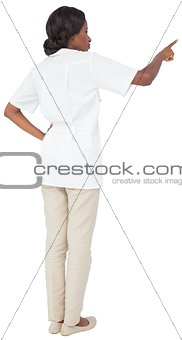 Young nurse in tunic pointing