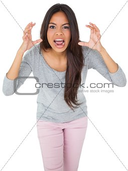 Angry casual young brunette shouting