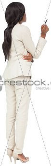 Thinking businesswoman in cream suit