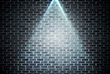 Grey brick wall under spotlight