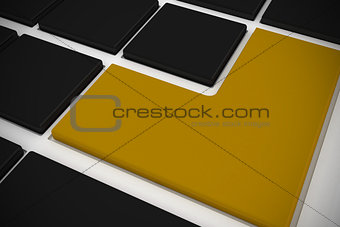Black keyboard with yellow key