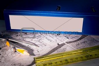 Blue business binder on a desk
