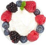 Meringue dessert with fruit and cream