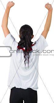Football fan in white cheering
