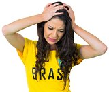 Disappointed football fan in brasil tshirt