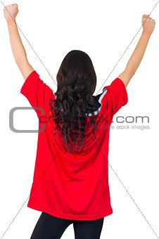 Football fan in red jersey cheering