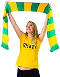 Excited football fan in brasil tshirt