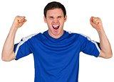 Cheering football fan in blue