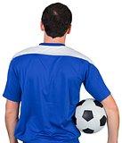 Football fan in blue holding ball
