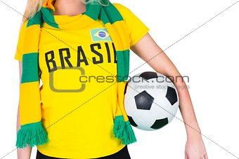 Football fan in brasil tshirt holding ball