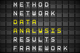 Data analysis buzzwords on black mechanical board