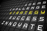 Strategy buzzwords on black mechanical board