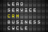 CRM buzzwords on black mechanical board