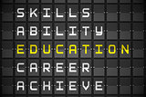 Education buzzwords on black mechanical board