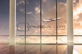 Airplane flying past window at sunrise