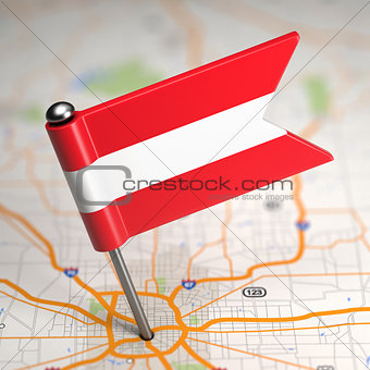 Austria Small Flag on a Map Background.