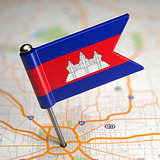 Cambodia Small Flag on a Map Background.